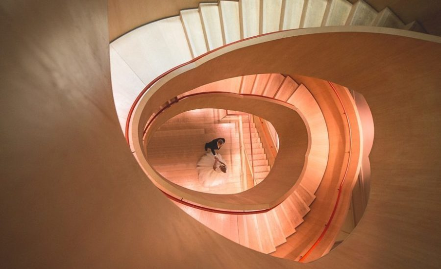 Birde and Groom dancing at the winding staircase of Coworth park