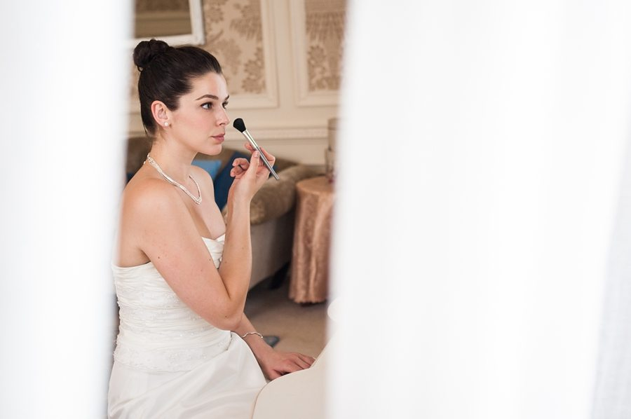 Bride getting ready at Great Fosters bridal prep suite