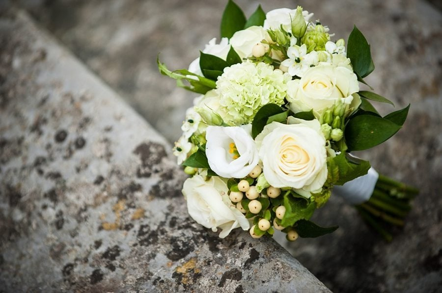 Bridal bouquet lying on the steps at Great Fosters