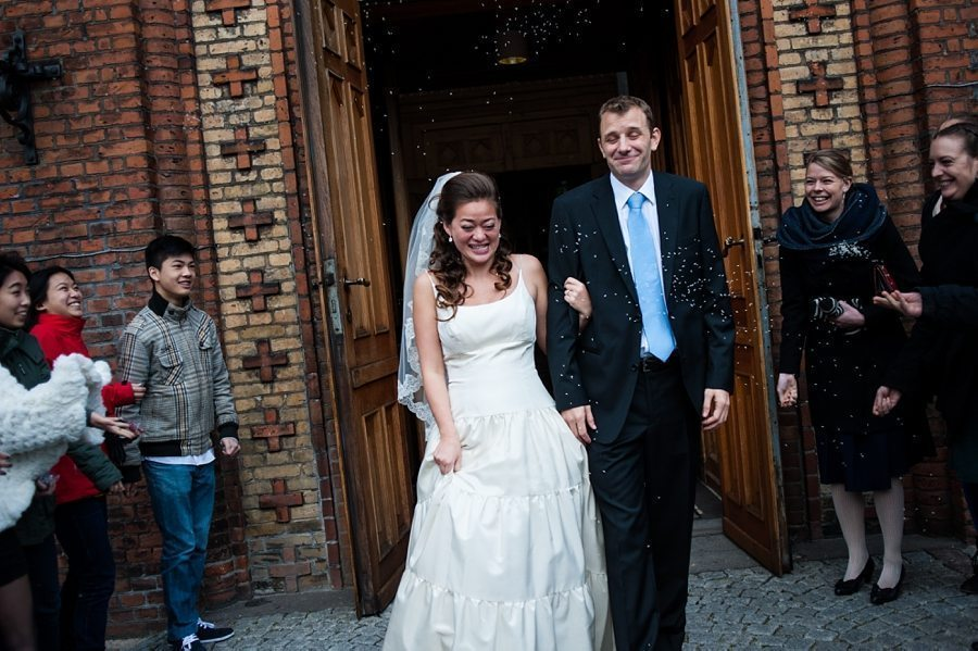Confetti in front of the church at a Destination winter wedding by Copenhagen wedding photographer