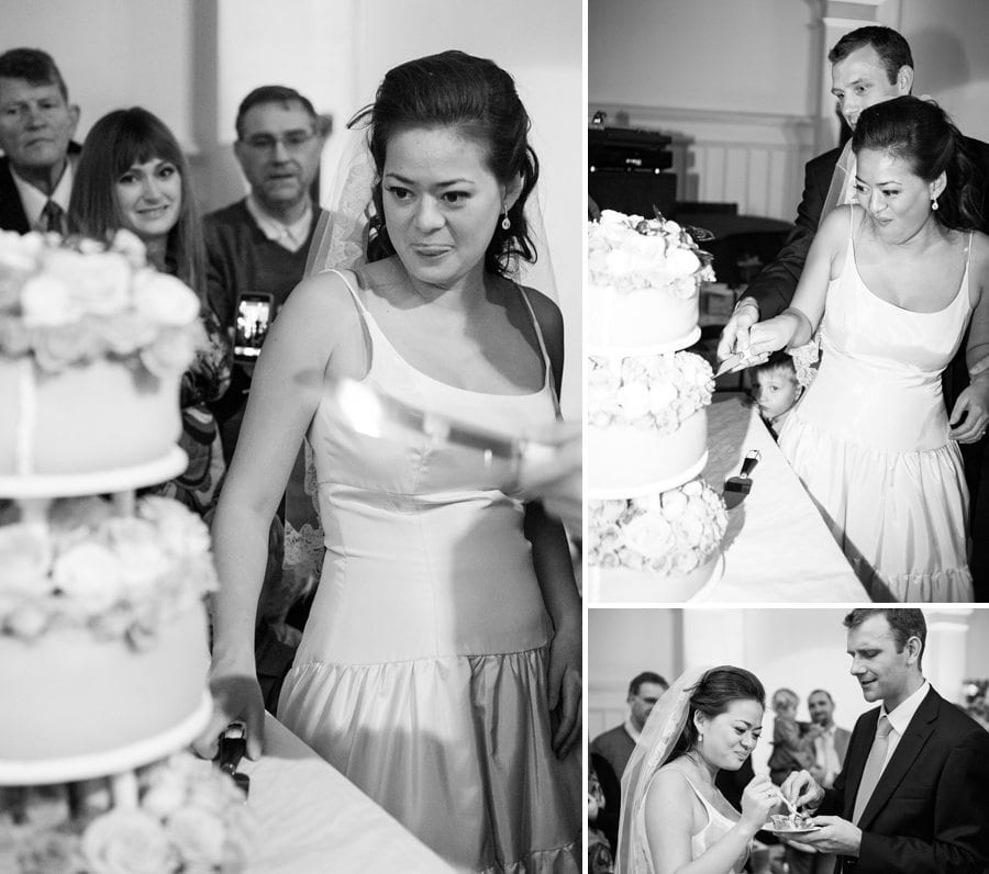 Bride and groom cutting the cake at their destination winter wedding in Copenhagen