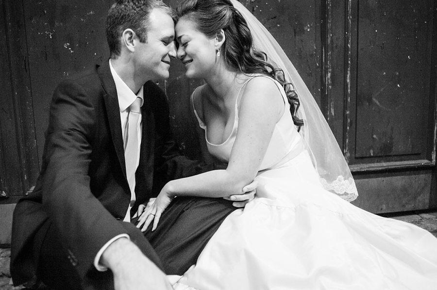 Bride and groom sitting in a copenhagen doorway
