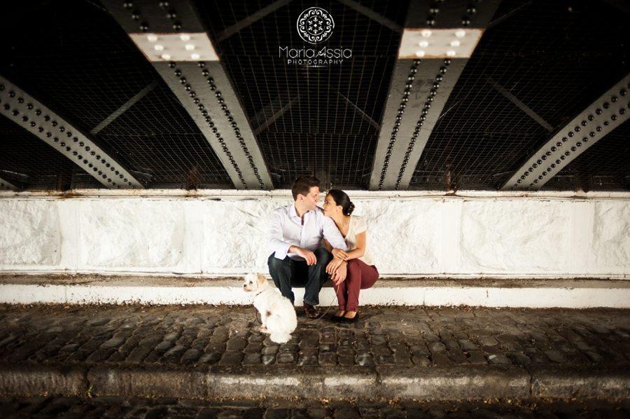 Elopement couple sit under a Regent's Canal Bridge with their little dog