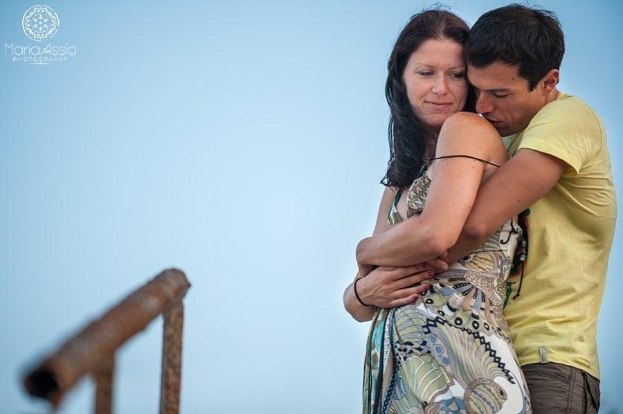 A man kissing his fiancé's shoulder on their Black Sea Evening pre wedding shoot destination wedding photographer