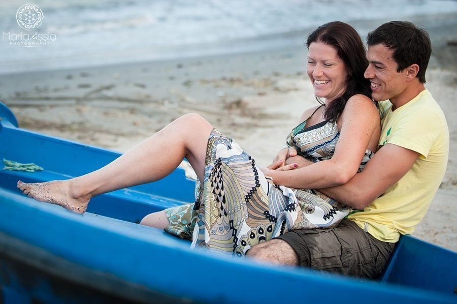 Couple sitting in a boat on their black sea evening pre wedding shoot
