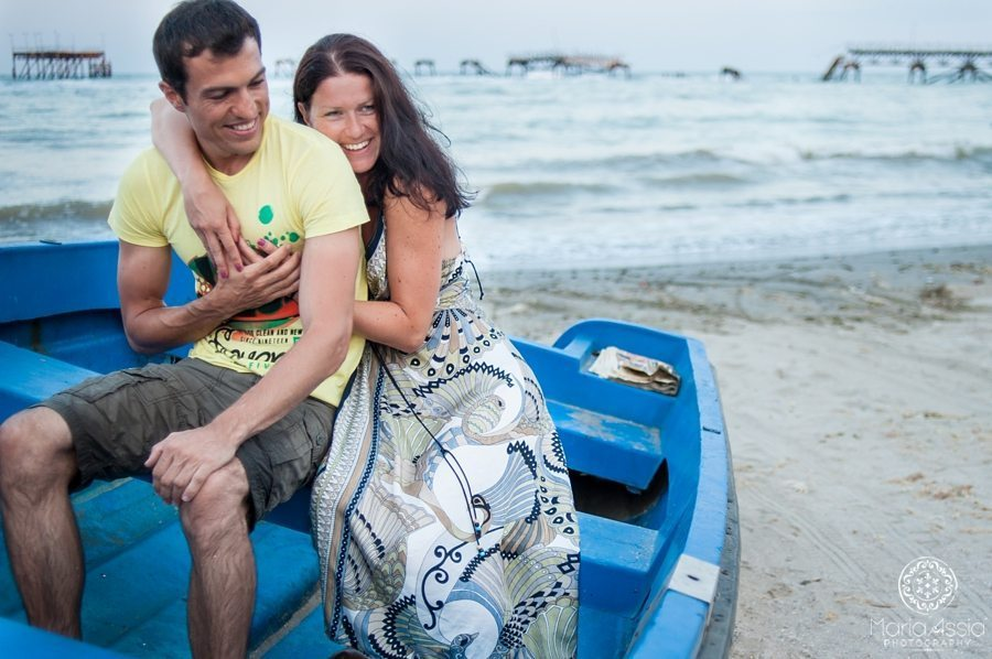 Black Sea Evening pre wedding shoot couple hugging on a boat at the beach