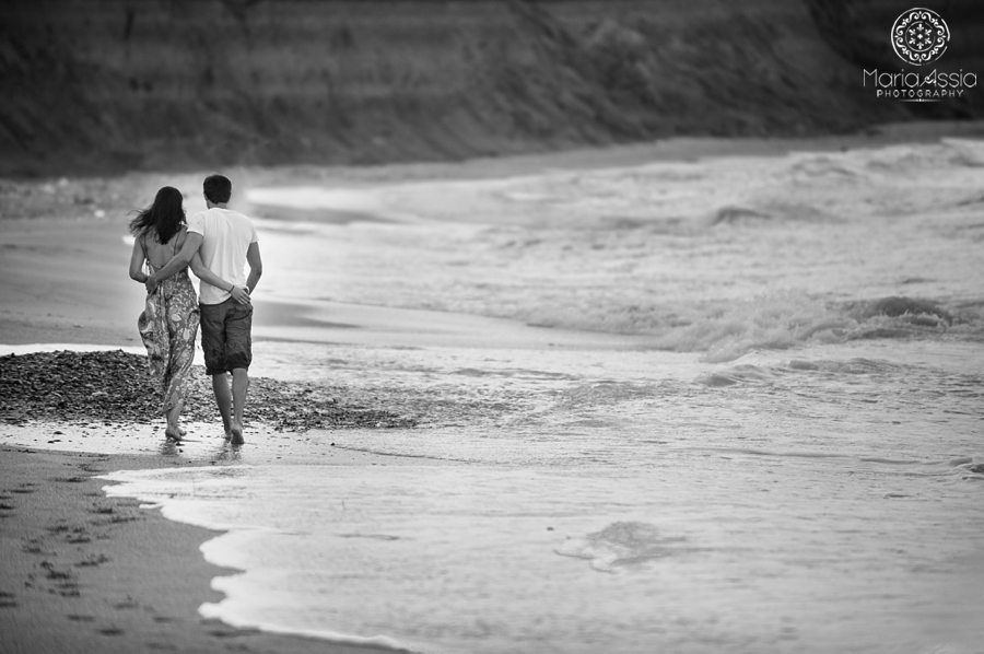 Couple walking on the beach by International Wedding Photographer Maria Assia Photography