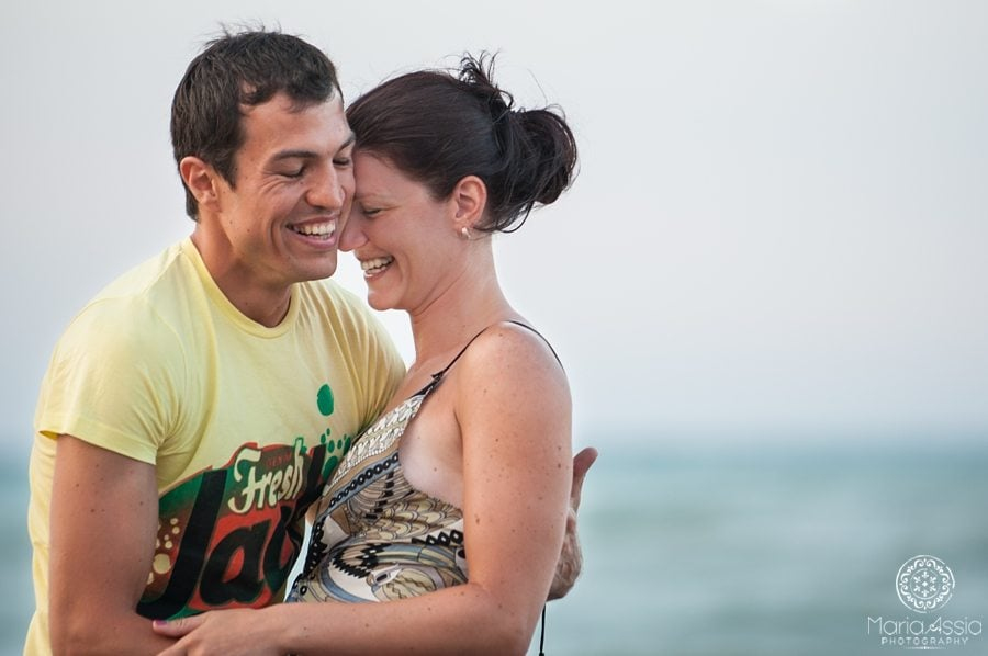 Couple laughing out loud on their Black Sea Evening pre wedding shoot in Bulgaria