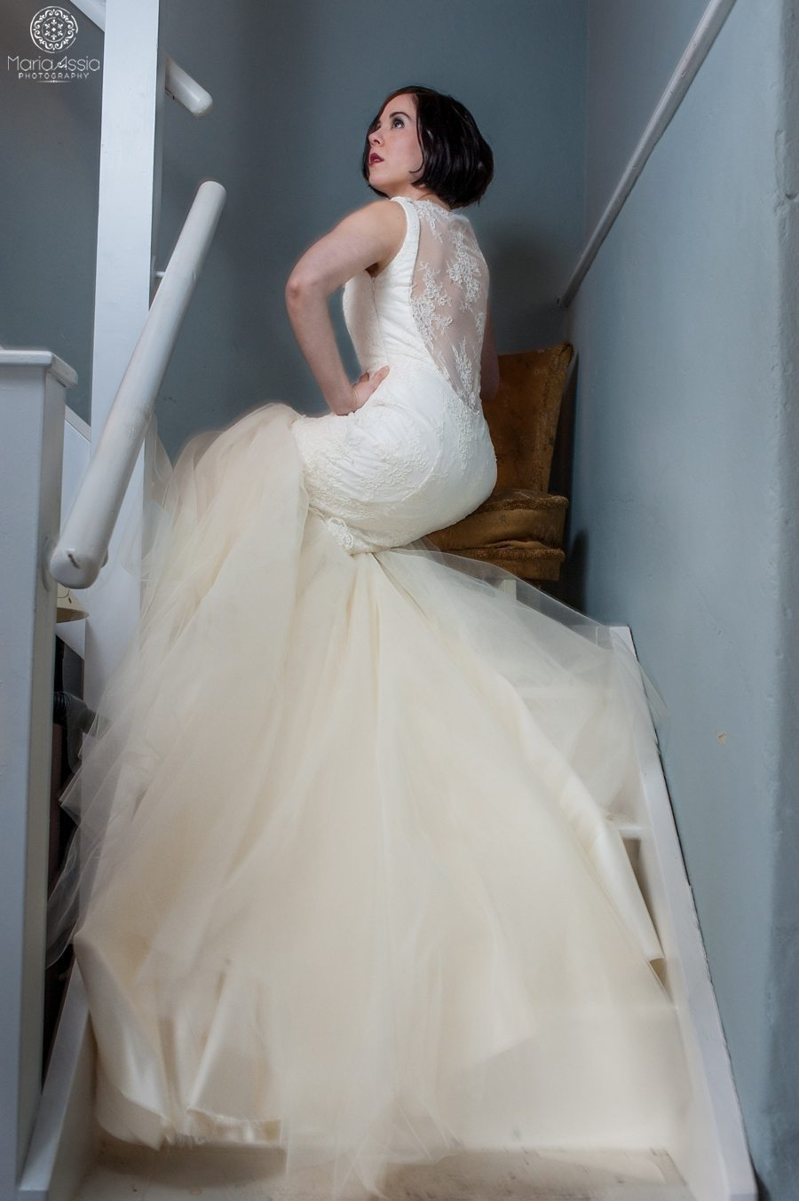 Bride looking up the stairs