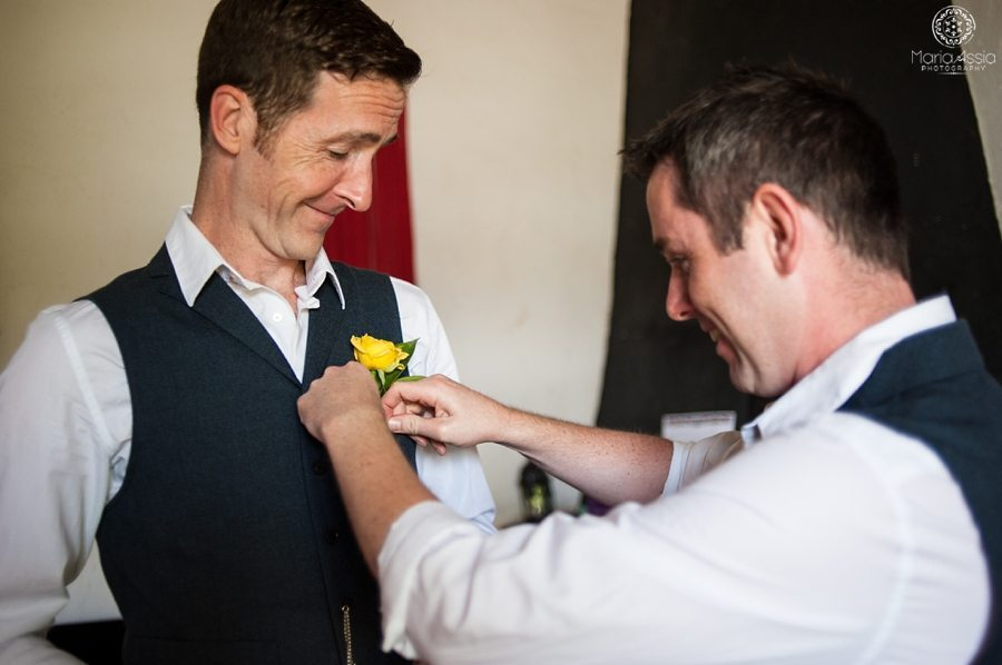 Pinning the groom's button hole