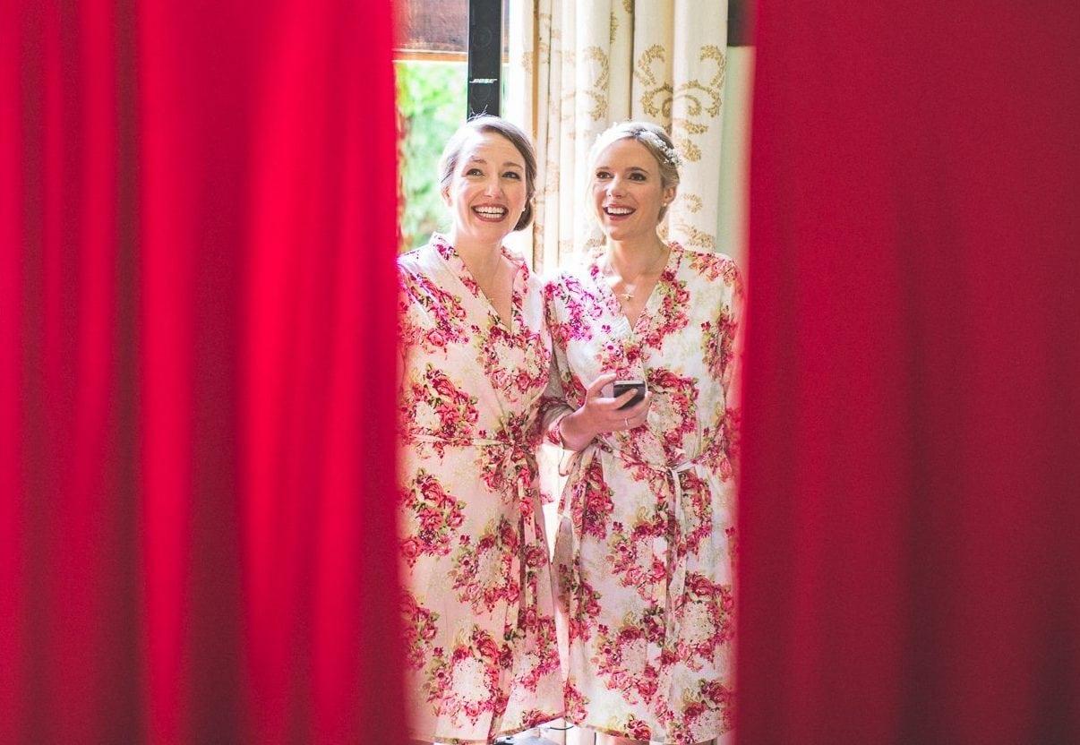 Bride and bridesmaids looking at the wedding dress and bridesmaids dresses