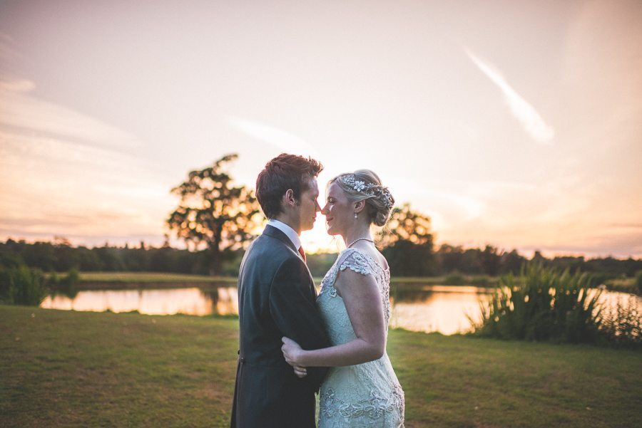Coworth park's breathtaking couple shoot location at the lake at sunset