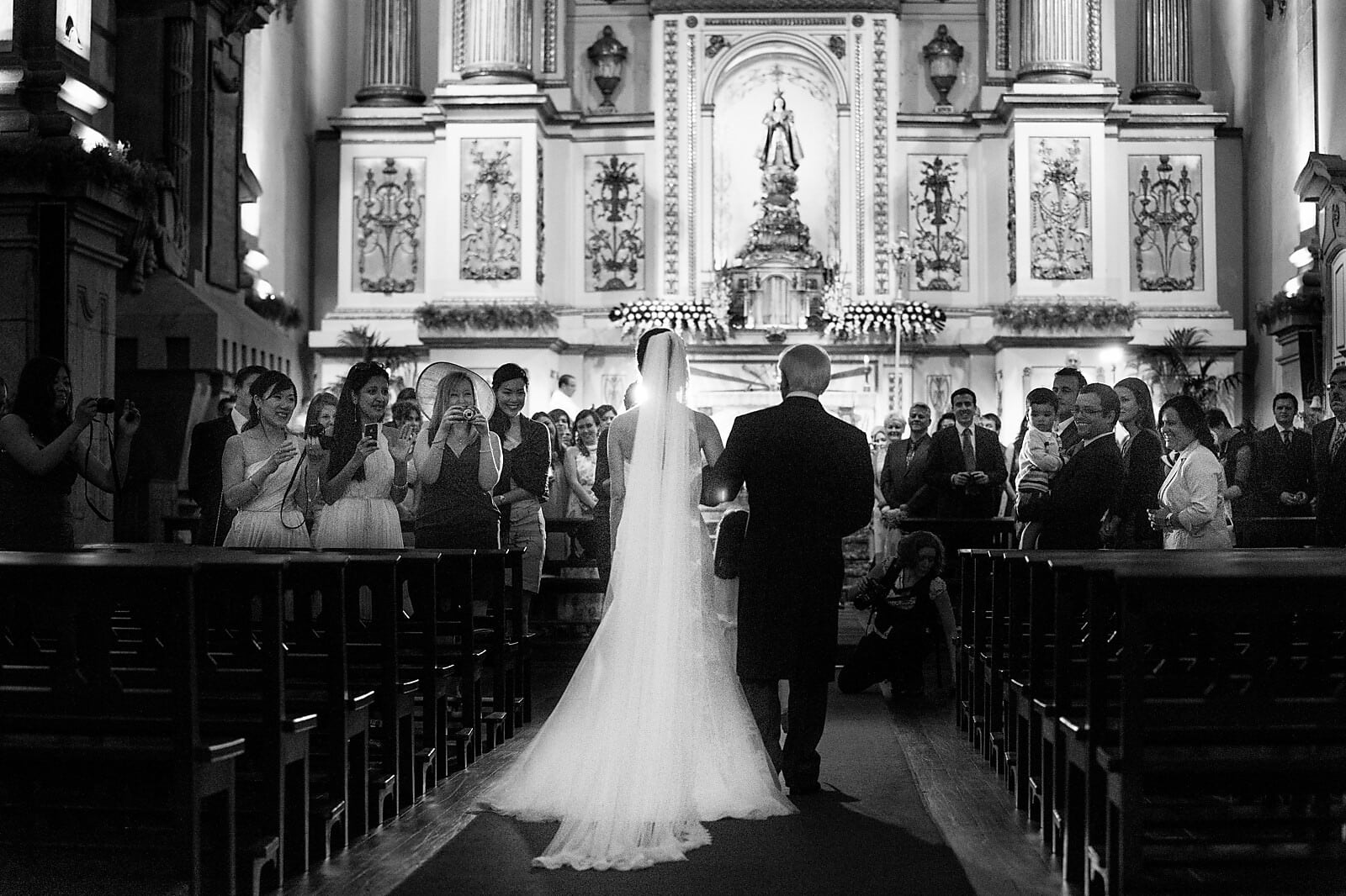 Bride walks up the aisle with her dad at her Porto Destination Wedding