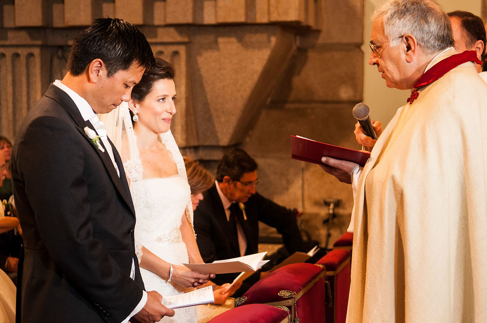 Bride smiles up at her priest at her Porto Destination Wedding