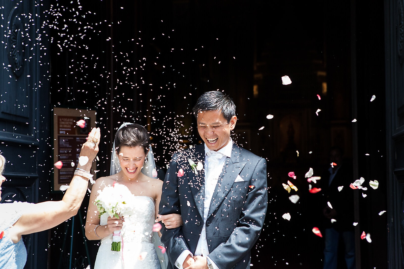 Confetti shower over the married couple at a Porto Palácio do Freixo Destination Wedding