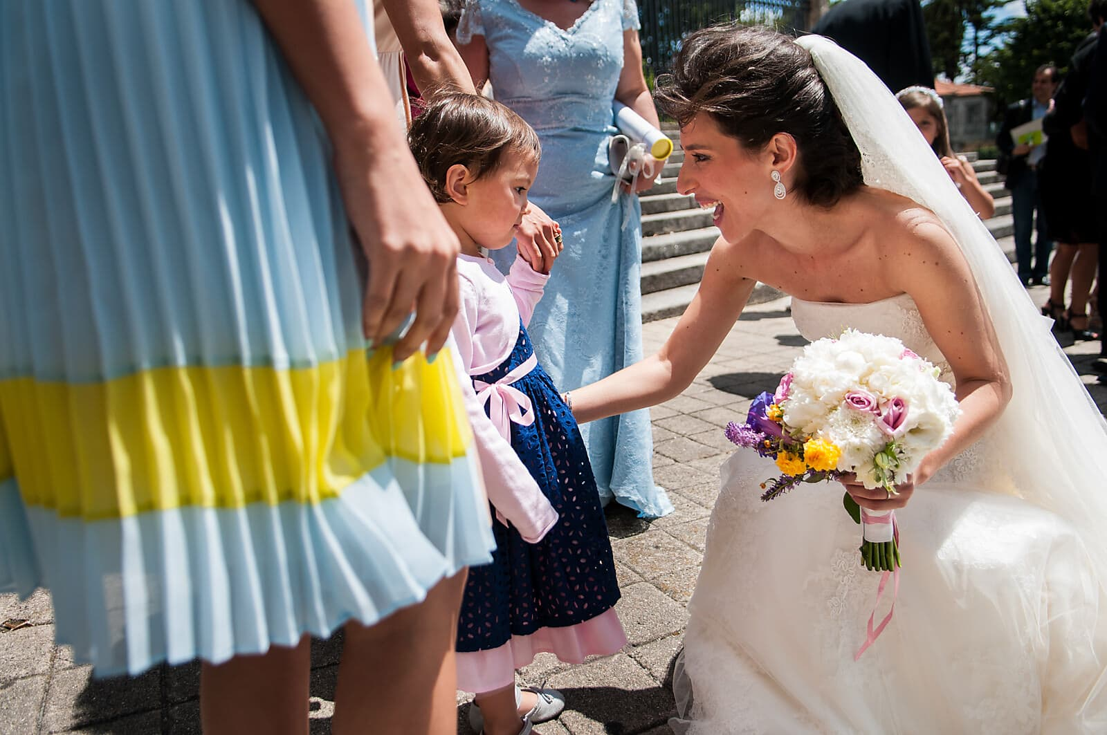Bride greets a little girl at her Porto Wedding