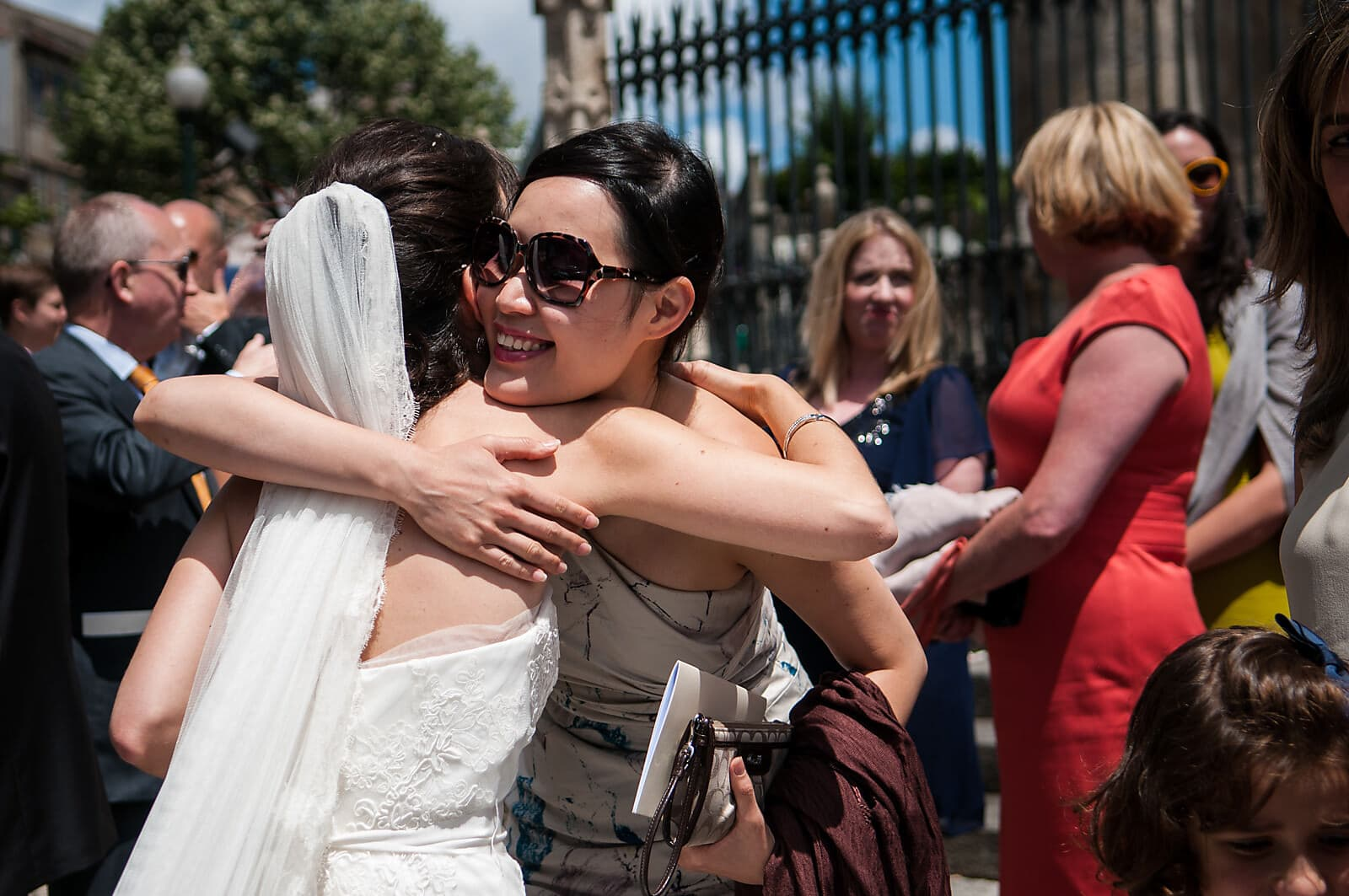 Bride hugs her wedding guest after her Porto destination wedding ceremony