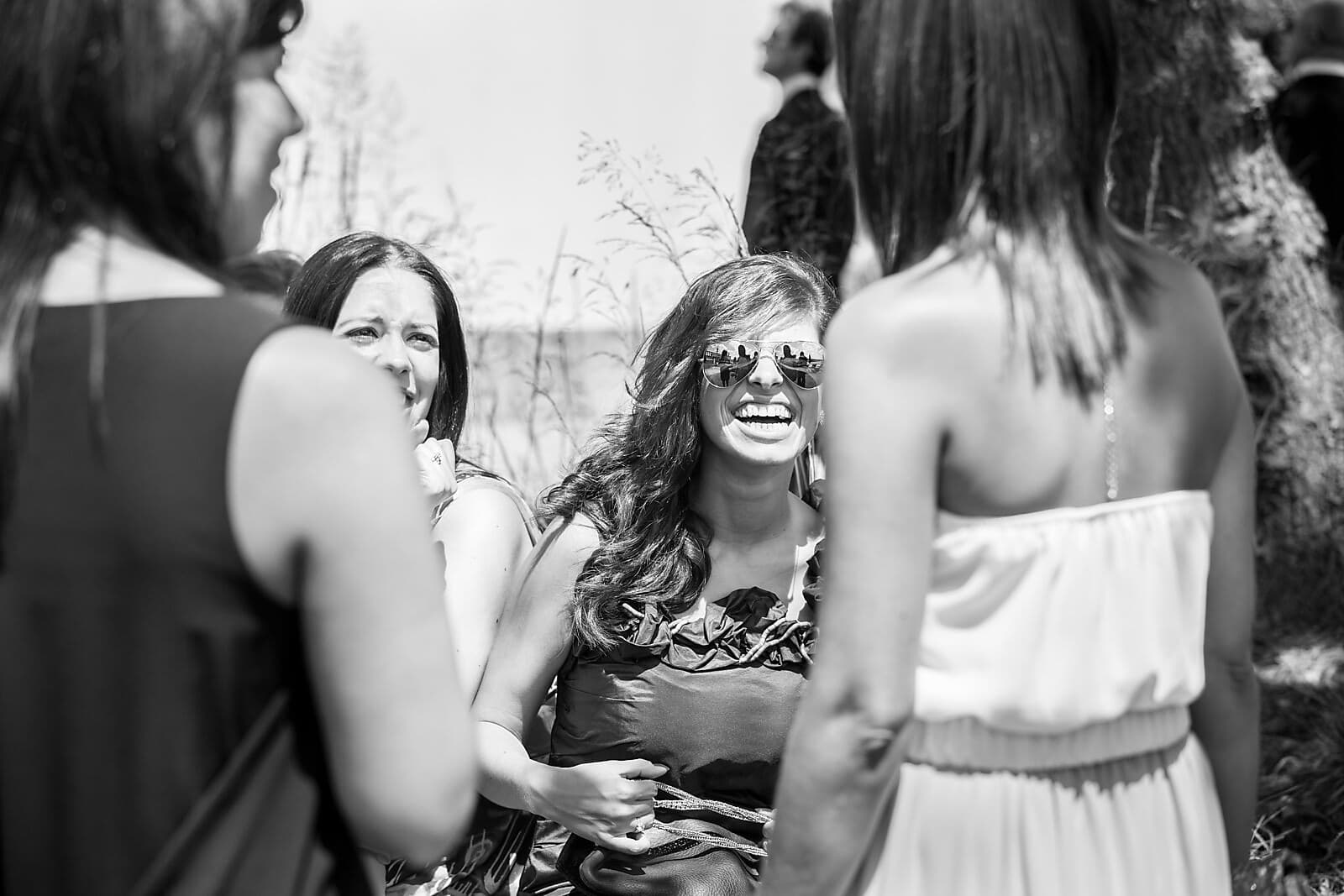 wedding guests laugh and chat at Porto Palácio do Freixo
