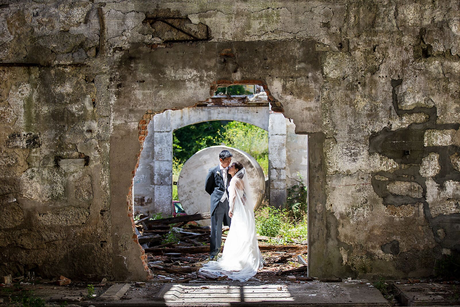 Bride and groom hug in a ruin in Porto