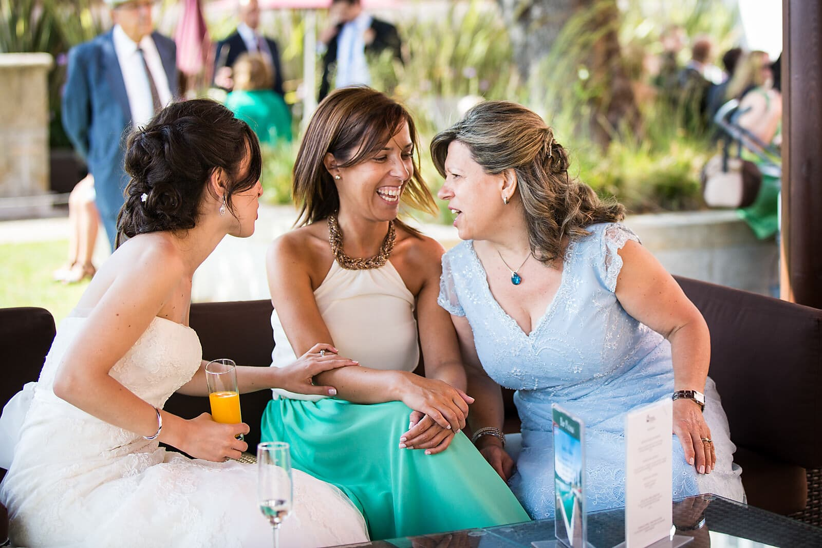 Bride laughs with her wedding guests