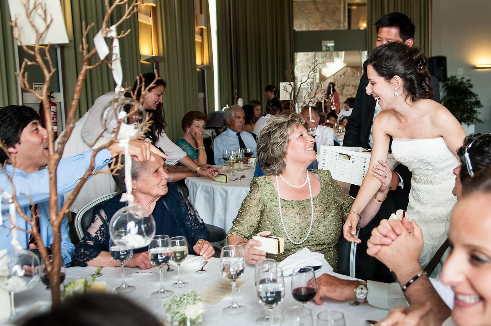 Bride greets her wedding guests at her Palácio do Freixo Wedding reception