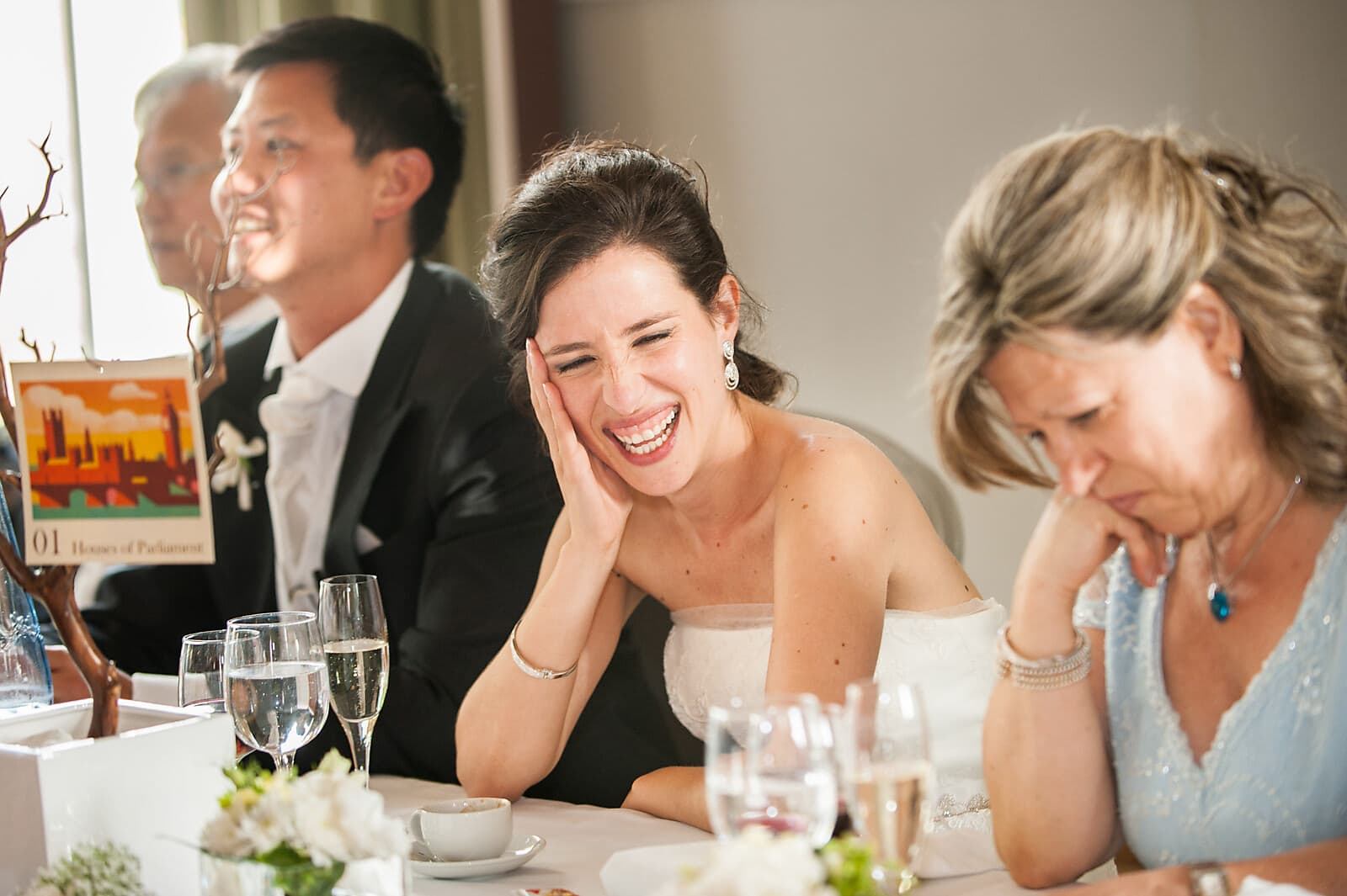 Bride laughs at the speeches at her Porto wedding