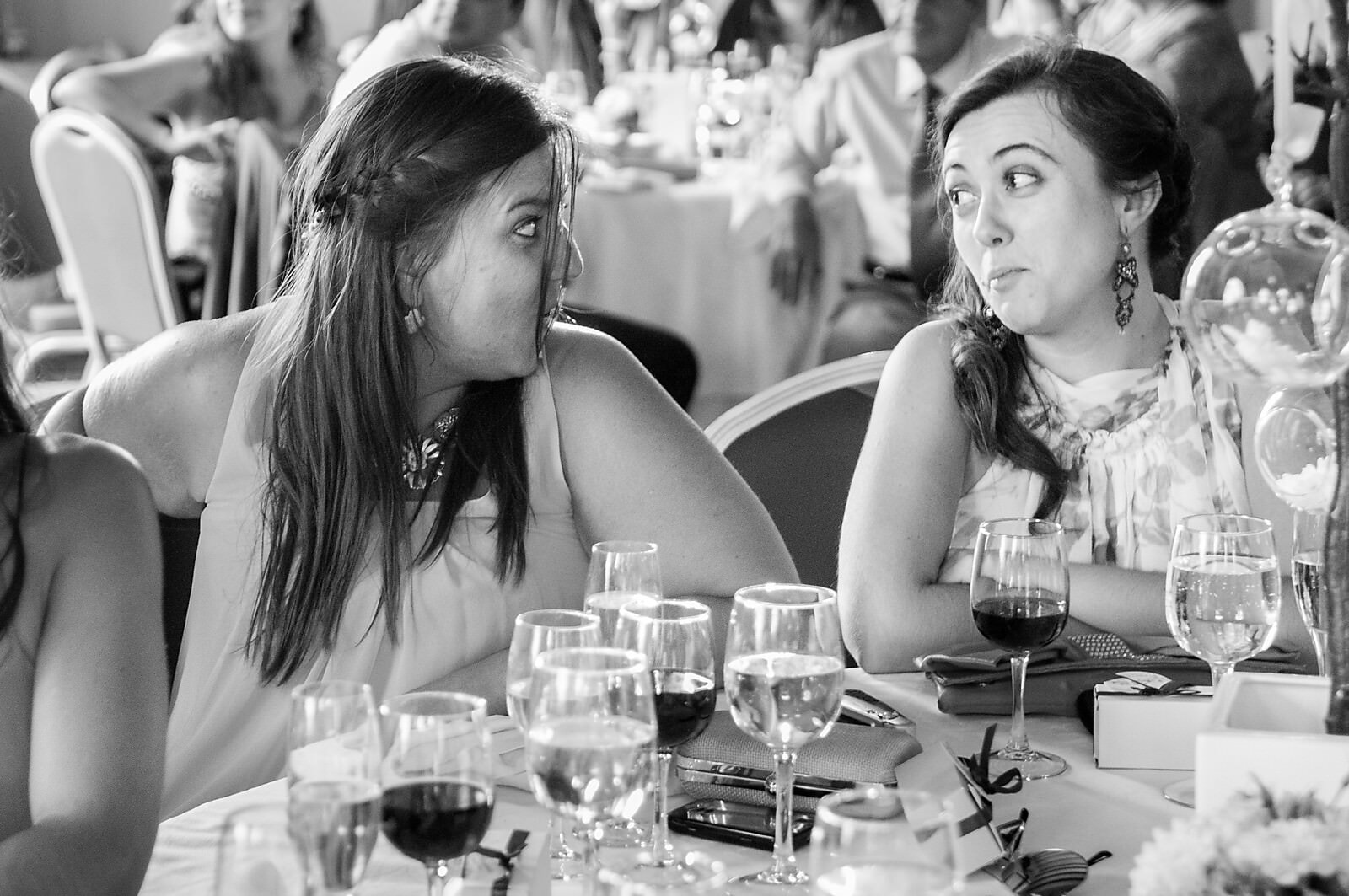 Wedding guests react surprised to the wedding speeches