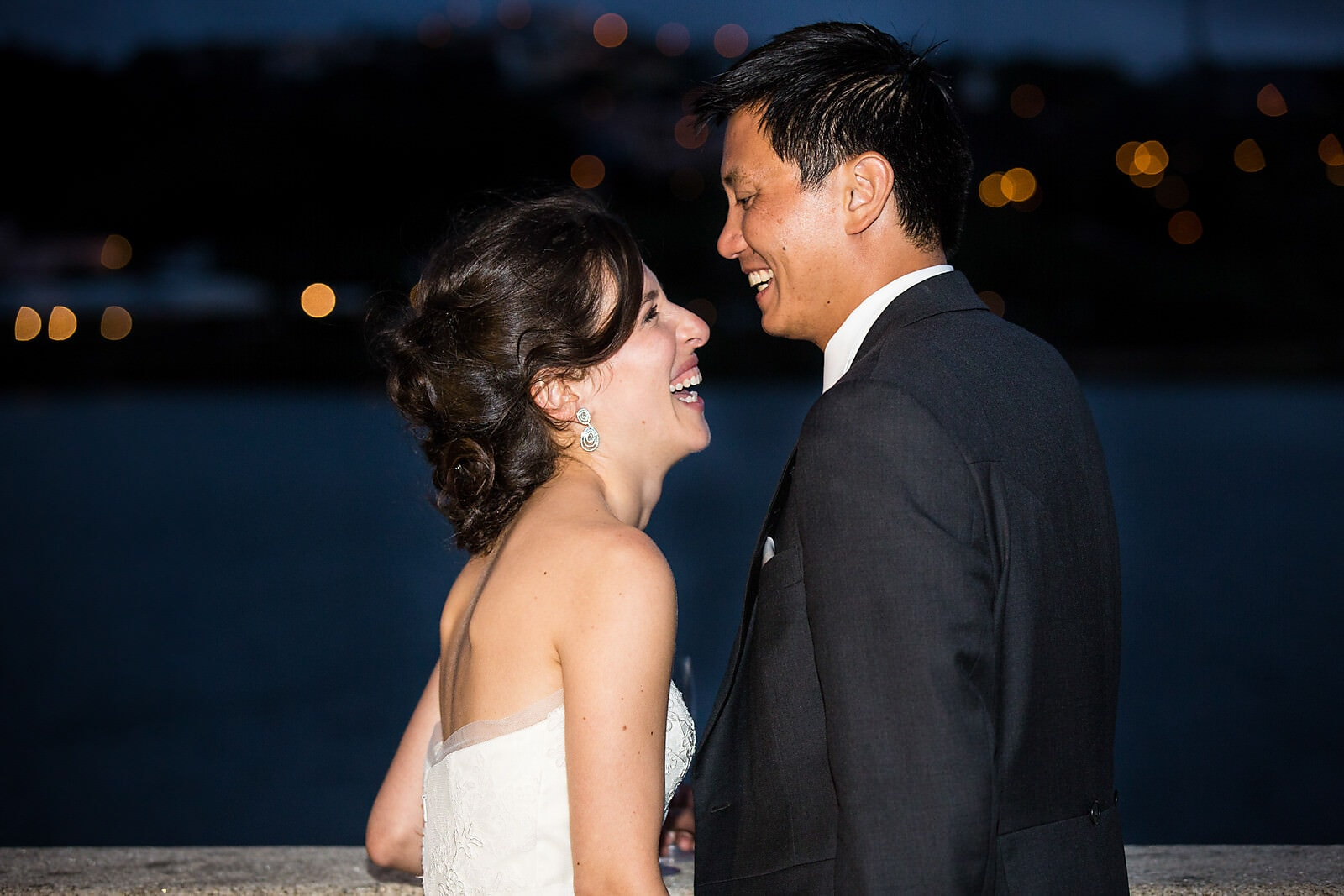 Bride and groom laugh together at their Porto Palácio do Freixo Destination Wedding