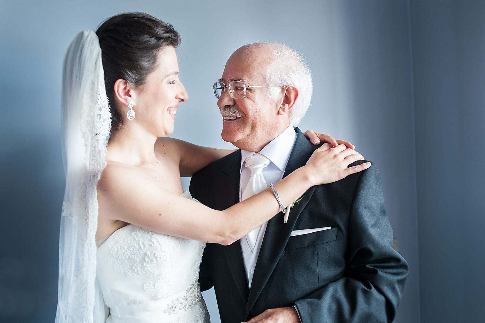 Porto Bride hugs her father ahead of her wedding ceremony