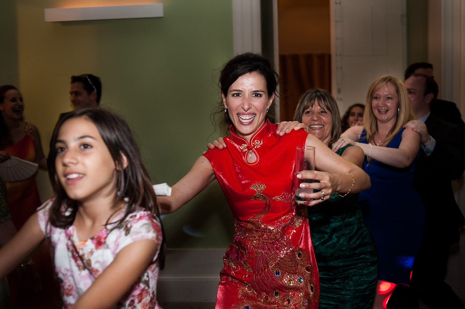 Bride dances in a conga line at her destination wedding