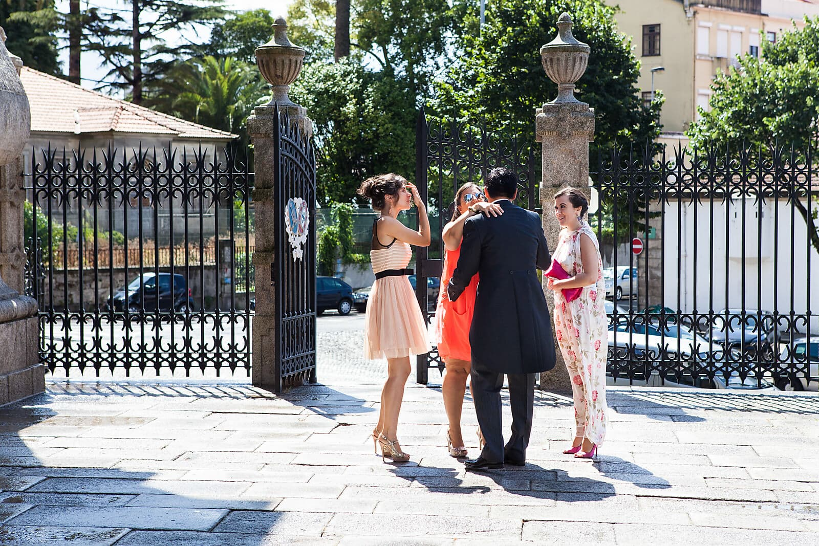 Groom greets wedding guests at a Porto Church