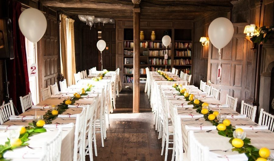 Wedding Tables decorated with lemons, greens and white balloons