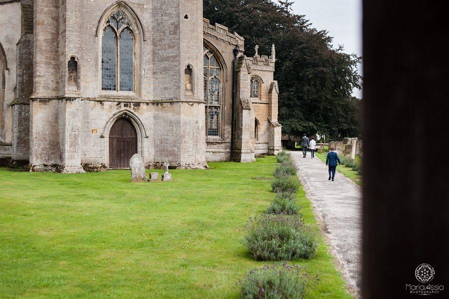 Groom walking up to St. Peter's Church Walpole
