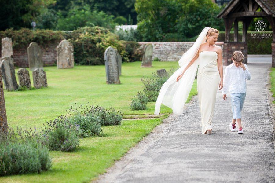 Bride walking up to the church, St Peter's Church Walpole, Norfolk wedding photographer