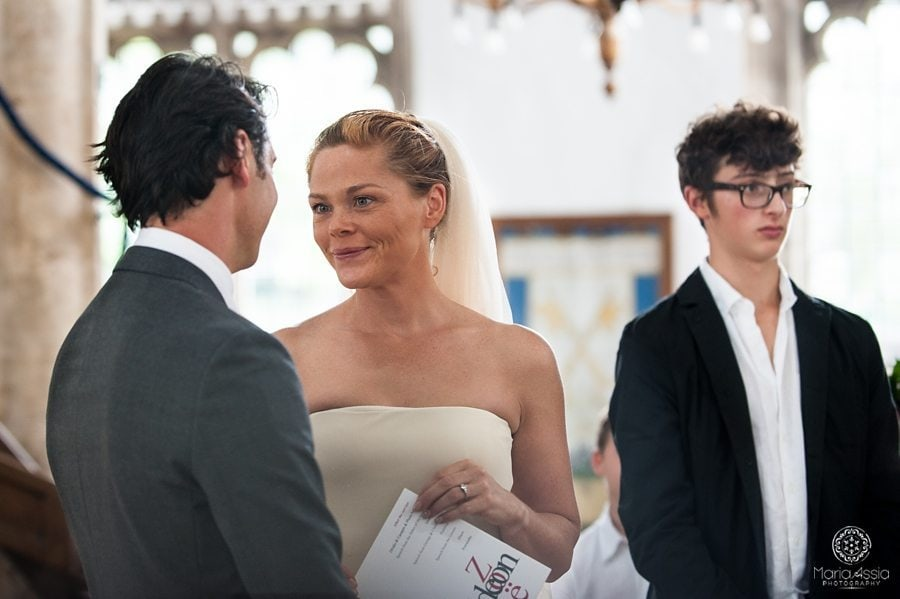 Bride and groom look at each other at the wedding ceremony, Wedding ceremony, Norfolk wedding photographer