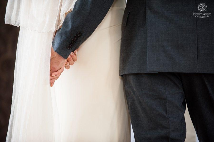 Bride and Groom holding hands, bridal veil