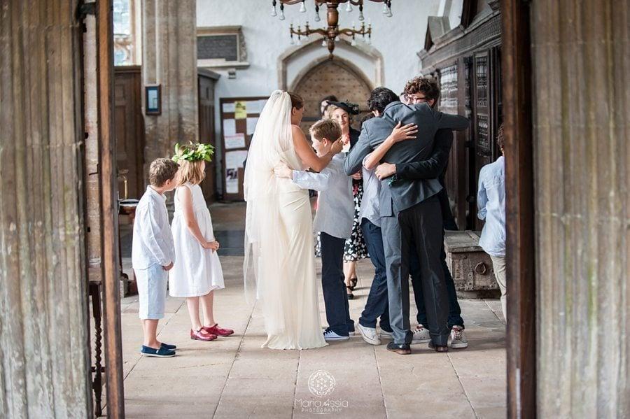 Norfolk Bride and groom hug their children