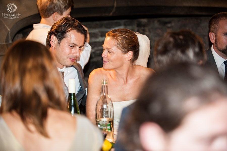 Norfolk bride and groom listening to speeches
