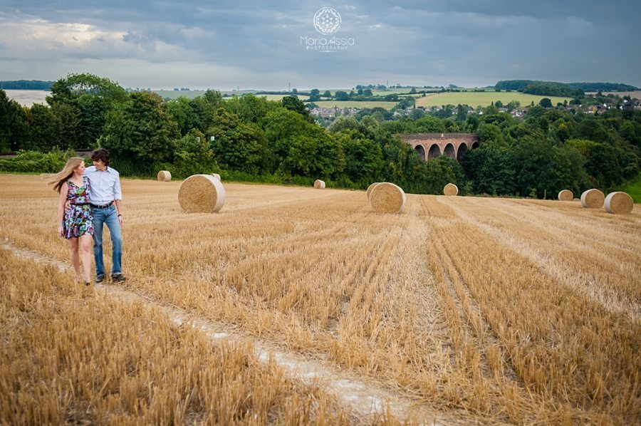 Eynsford viaduct, engaged couple walking in hay field