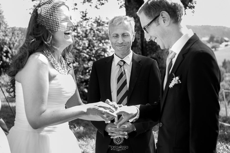 Bavarian Bride and groom exchanging rings