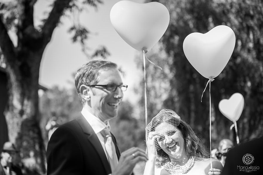 Bavarian Bride and groom holding balloons