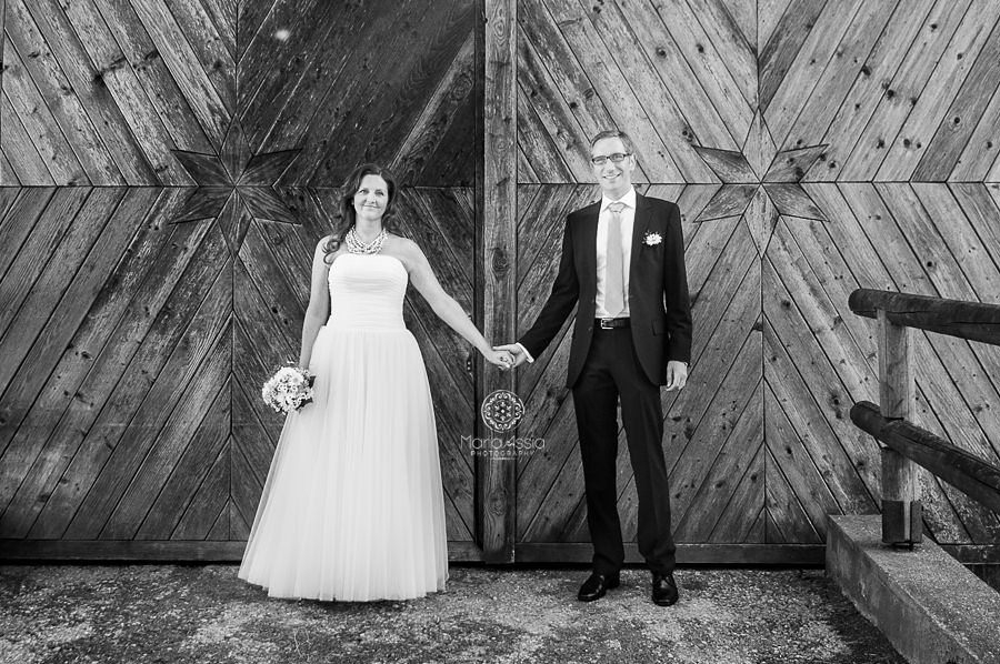 Bride and Groom barn door portrait