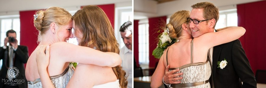 Bavarian Bride and Groom hugging maid of honour