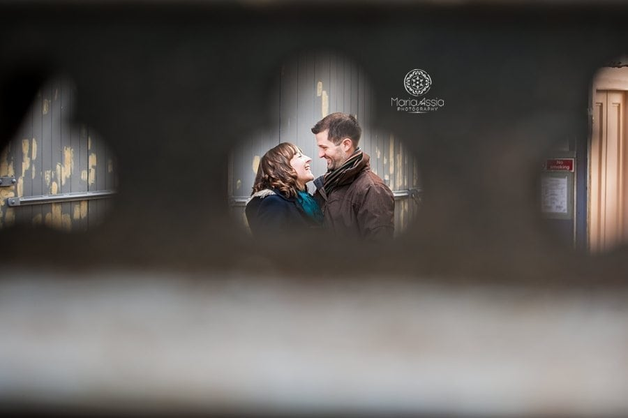 Engaged couple visible through stairs