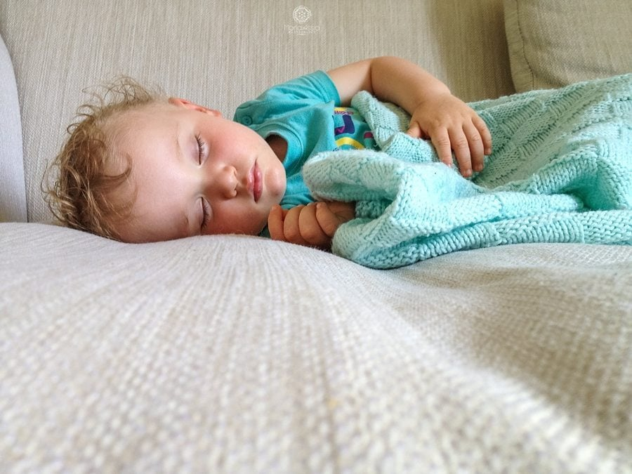 sleeping toddler with curly hair, documentary family photographer