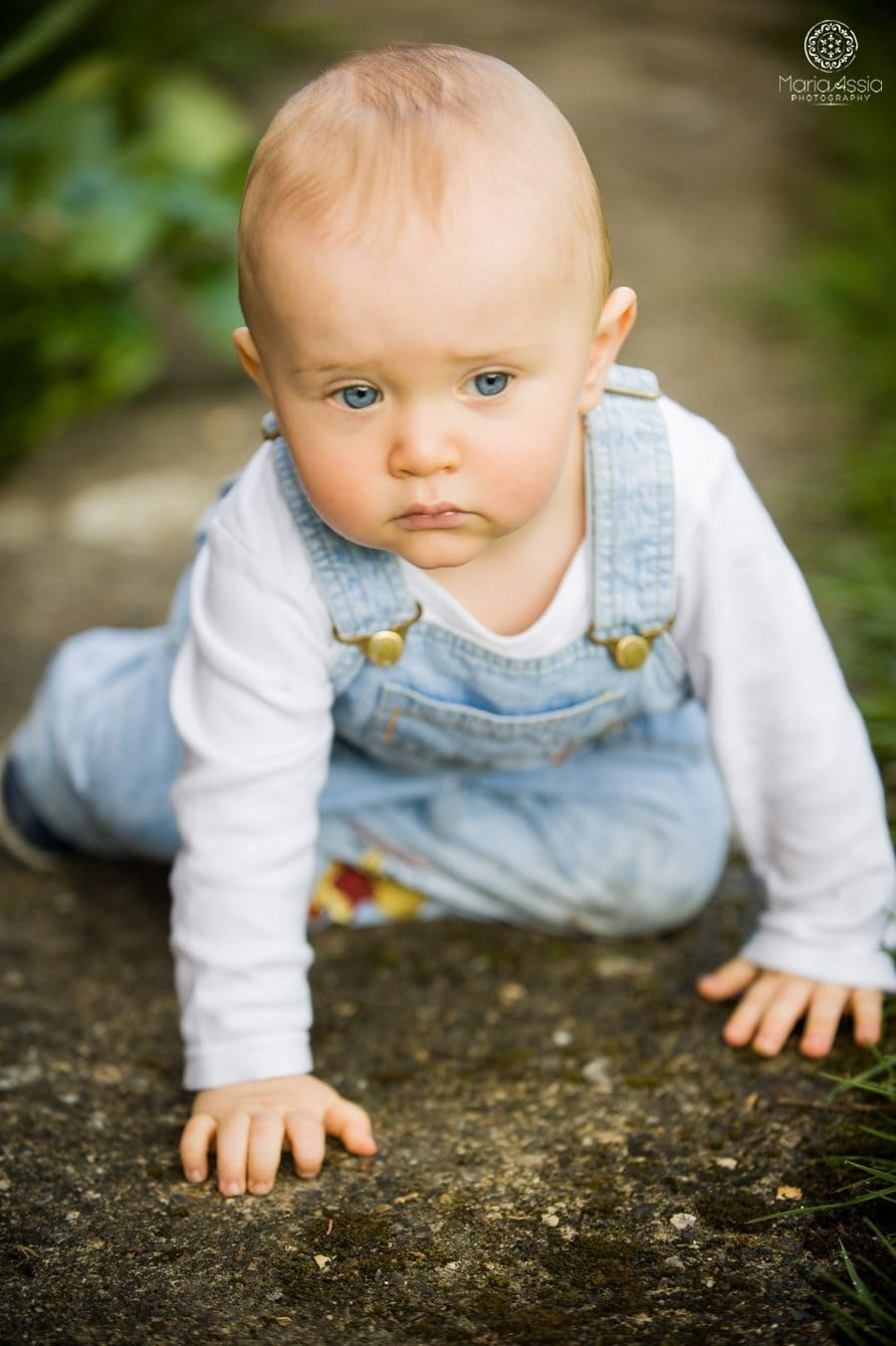 documentary family photography of a toddler crawling in the garden