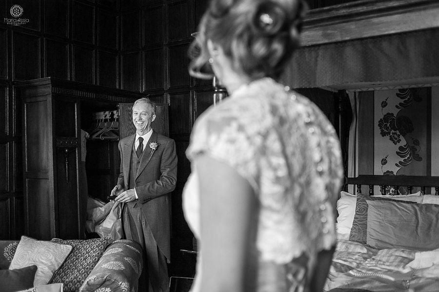 Bride's dad looking at her in her dress before her Billesley Manor Hotel Fuchsia Spring Wedding