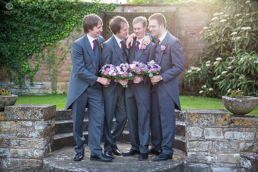 Groom and groomsmen fun wedding group shot at their Billesley Manor Hotel Fuchsia Spring Wedding