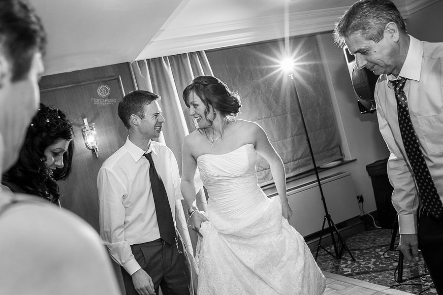 bride and groom dancing at their Billesley Manor Hotel Fuchsia Spring Wedding