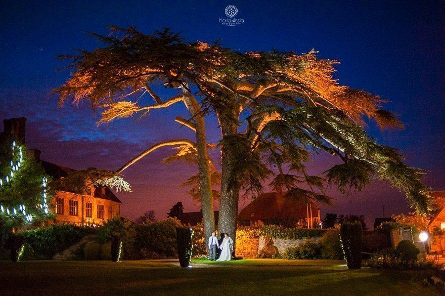Bride and groom night time portrait at their Billesley Manor Hotel Fuchsia Spring Wedding low light wedding portrait